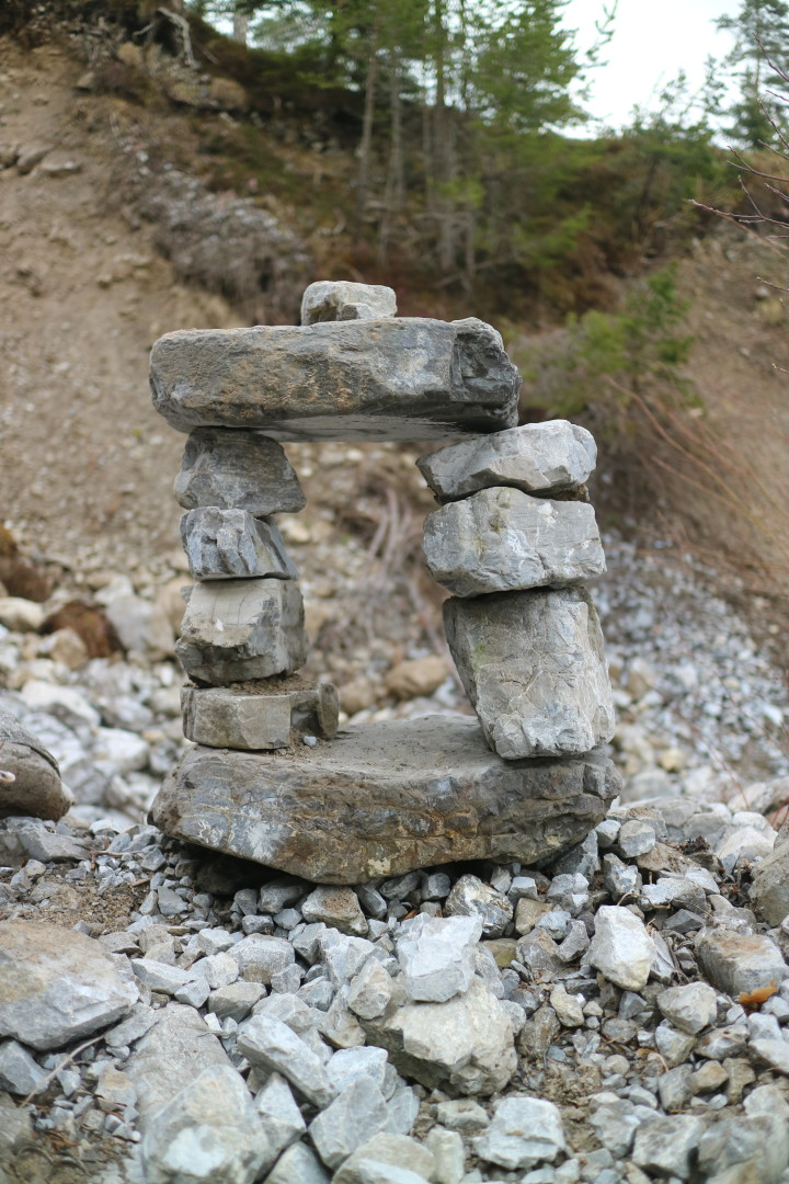 stone sculpture in a creek bed