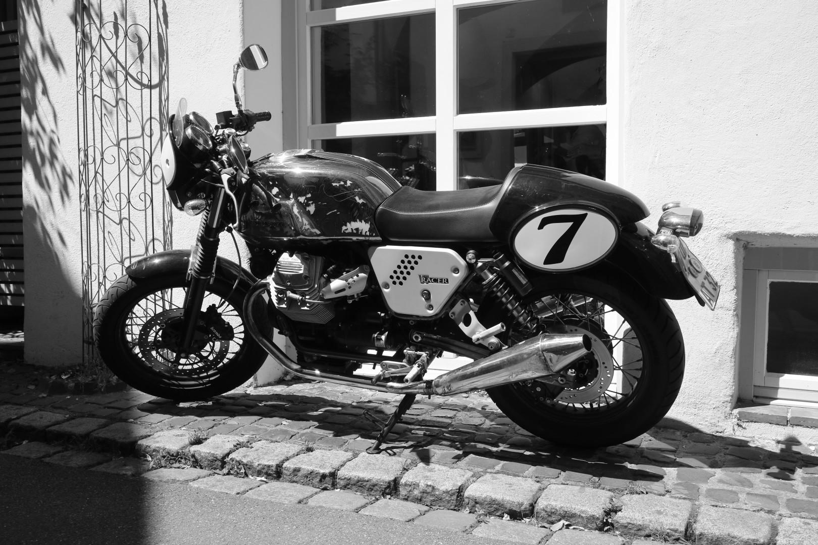 a Moto Guzzi bike, photographed in B/W