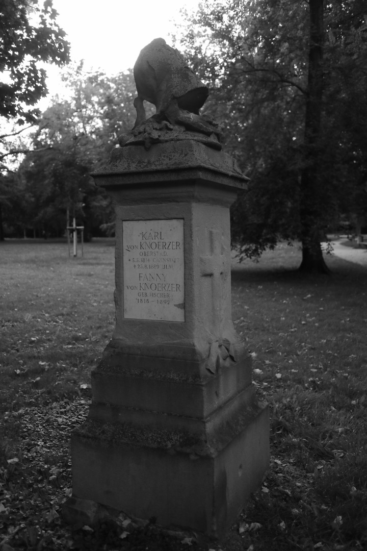 bw image of a gravestone in a park