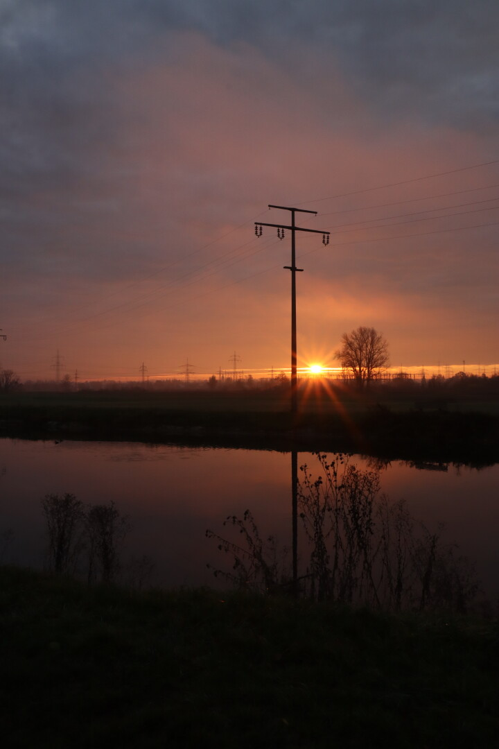 sunrise across a river