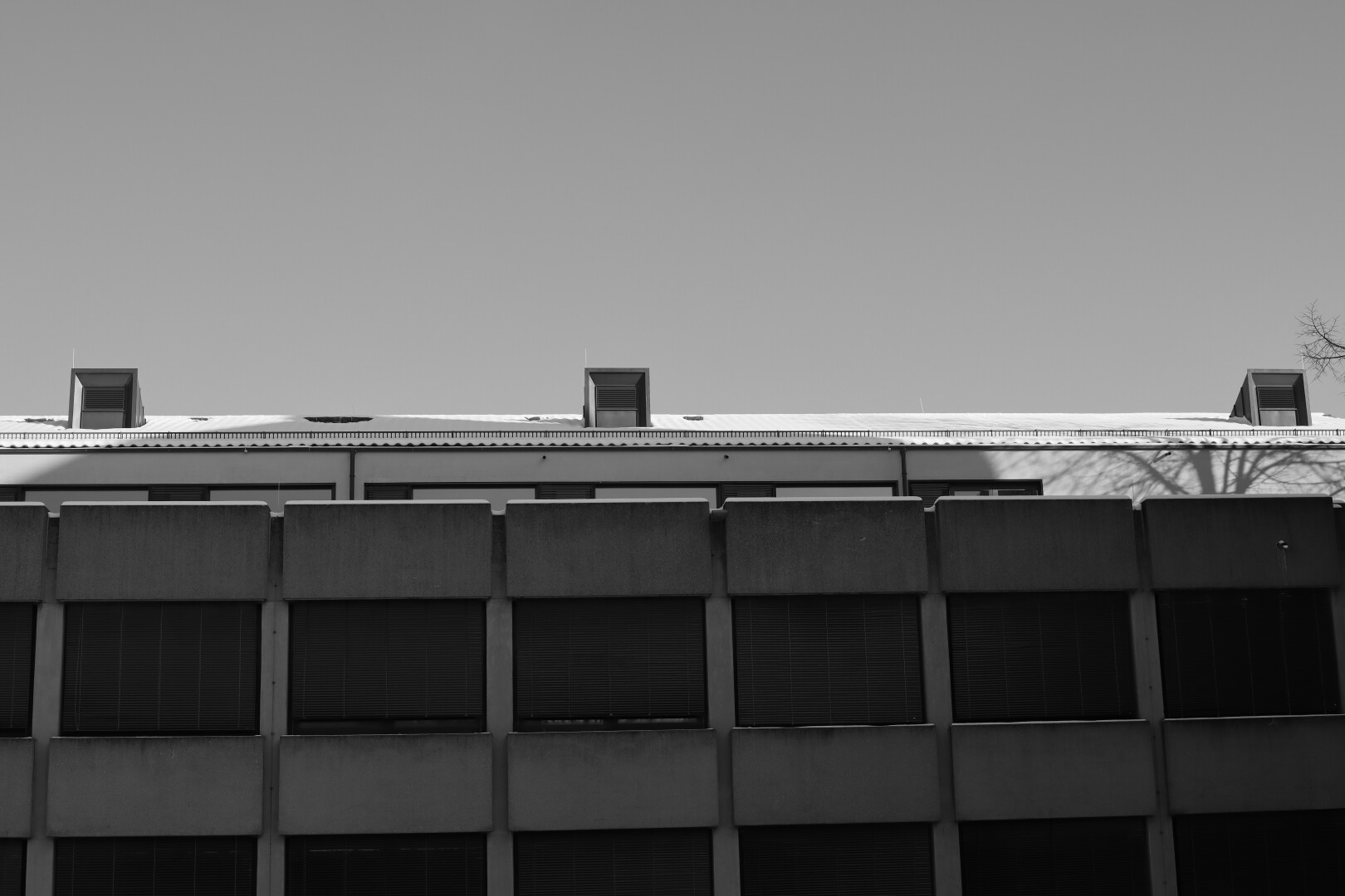 bw pic of part of a (brutalist?) building