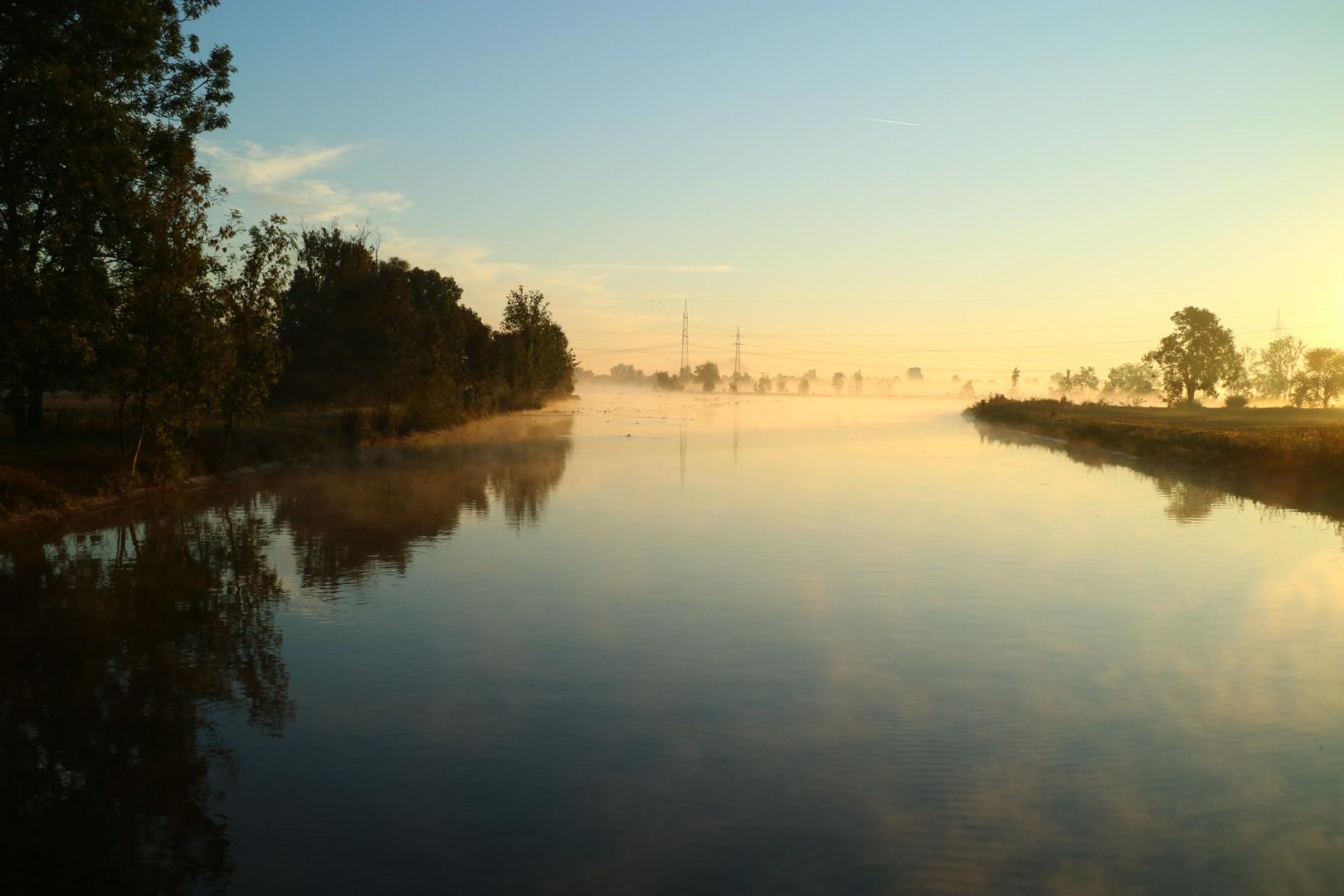 rising mist and rising sun